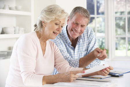 sorting out: Retired couple with household bills