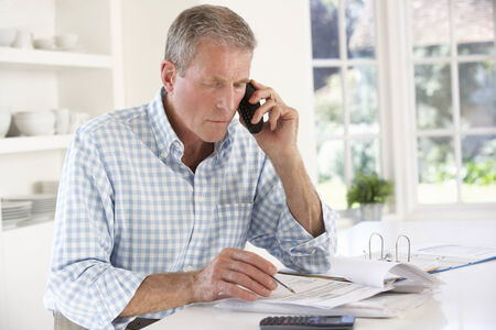 home expenses: Retired man with household bills