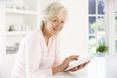 senior home: Senior woman using tablet at home