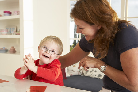 capable of learning: Downs Syndrome boyhaving speech therapy