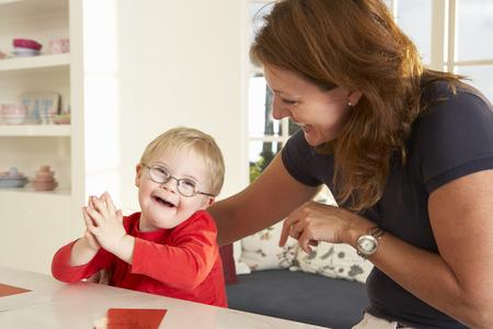 Downs Syndrome boyhaving speech therapy