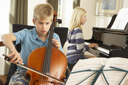 wallingford: Boy and girl playing cello and piano at home