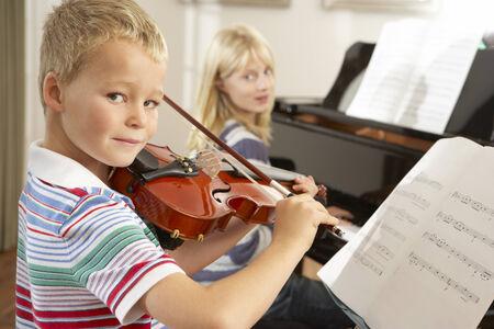 wallingford: Boy and girl playing violin and piano at home