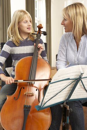 wallingford: Girl playing cello in music lesson
