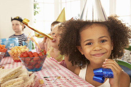 party dress: Young children eating at birthday party