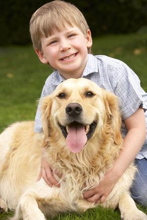 wallingford: Young boy in garden with golden retriever