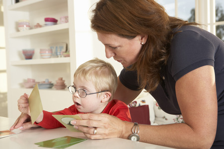 therapy: Downs Syndrome boyhaving speech therapy