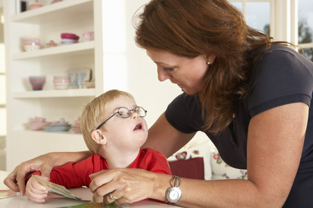 downs syndrome: Downs Syndrome boyhaving speech therapy