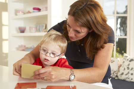 therapists: Downs Syndrome boyhaving speech therapy
