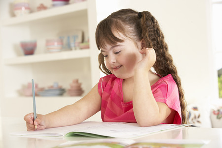 capable of learning: Girl with Downs Syndrome drawing