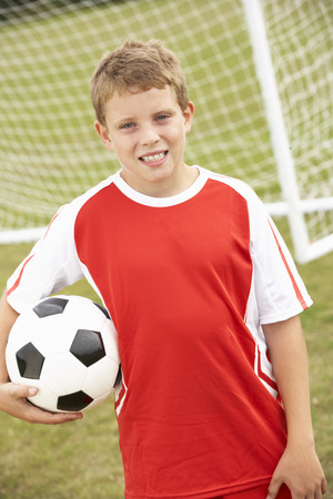 wallingford: Portrait boy in soccer kit with ball Stock Photo