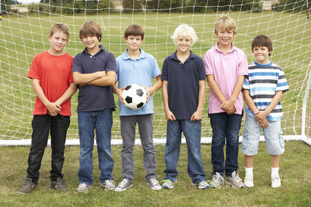 Portrait boys in park with football photo