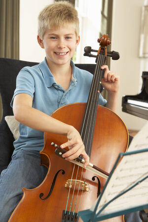wallingford: Boy playing cello at home