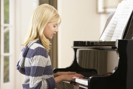 wallingford: Girl playing grand piano at home