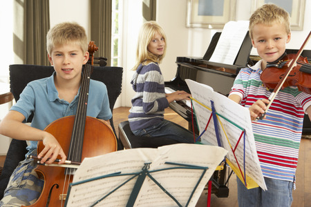 Children playing musical instruments at home photo