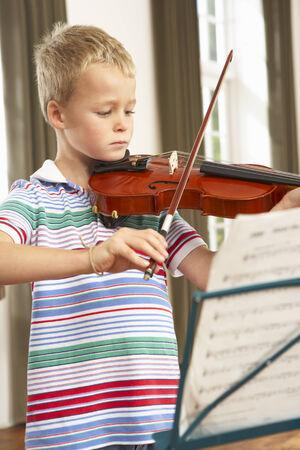 wallingford: Young boy playing violin at home
