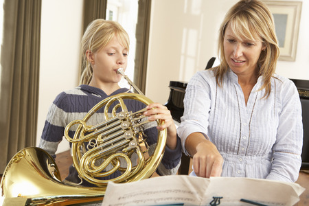 wallingford: Girl playing French horn in music lesson