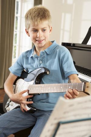 wallingford: Boy playing electric guitar at home