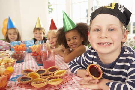 wallingford: Young children eating jam tarts at birthday party