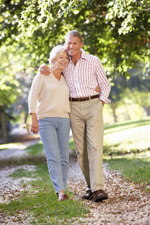 couple WALKING: Senior couple walking in park