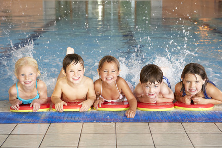 boy swim: Children in swimming pool