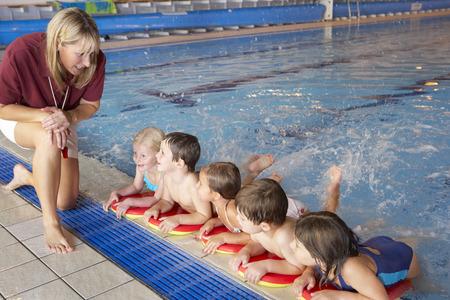 Children having swimming lesson 스톡 콘텐츠