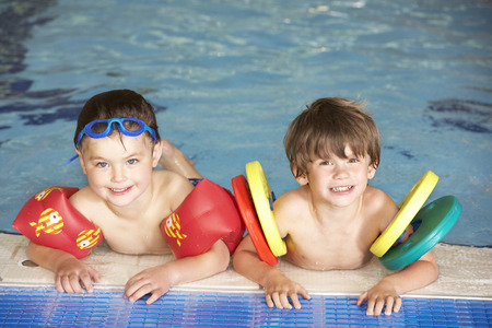 floats: Young boys in swimming pool