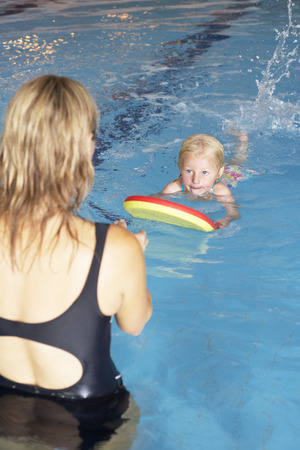 Young girl learning to swim photo