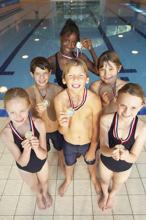 boy swim: Winning swimming team