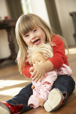 3 year old: 3 year old girl with Downs Syndrome Stock Photo