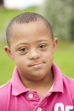 9 year old boy with Downs Syndrome Stock Photo
