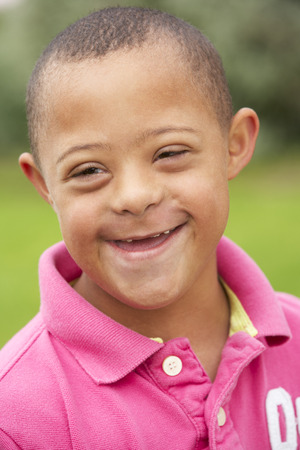 downs syndrome: 9 year old boy with Downs Syndrome Stock Photo