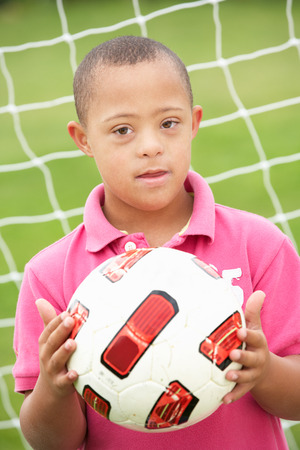 disabled sports: 9 year old boy with Downs Syndrome Stock Photo