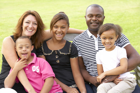 downs syndrome: Family with Downs Syndrome son Stock Photo