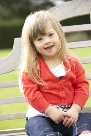 3 year old girl with Downs Syndrome Stock Photo