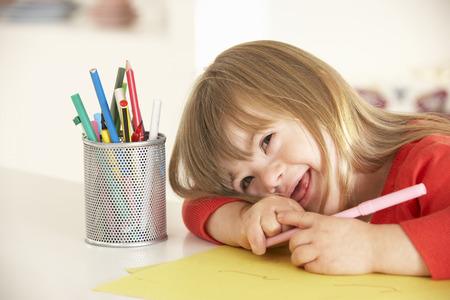 down's syndrome: Girl with Downs Syndrome drawing