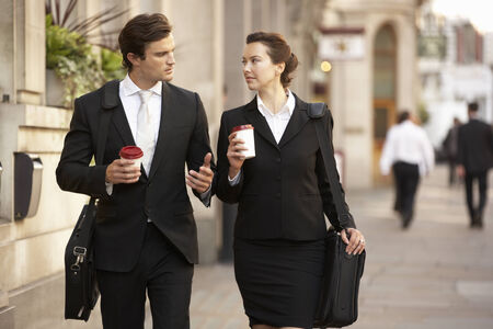incidental people: Businessman and businesswoman on their way to work