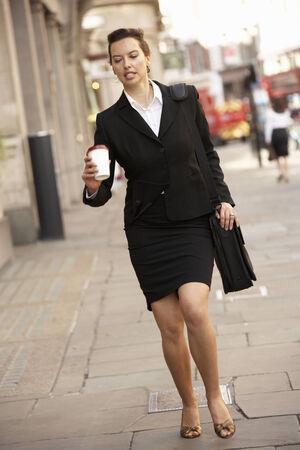 hurrying: Businesswoman hurrying to work