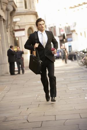 hurrying: Businessman hurrying to work Stock Photo