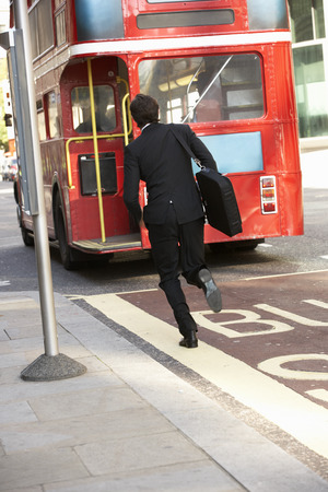 Businessman running for bus