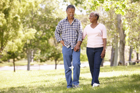 african tree: Senior  couple walking in park