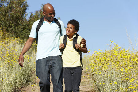 Father and son on country hike photo