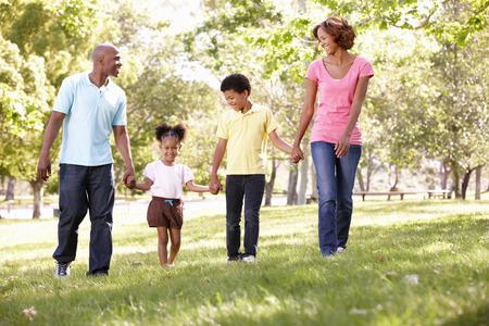 mixed race family: Family walking in park