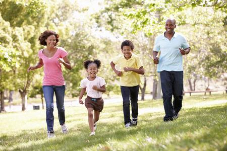 children running: Family running in park