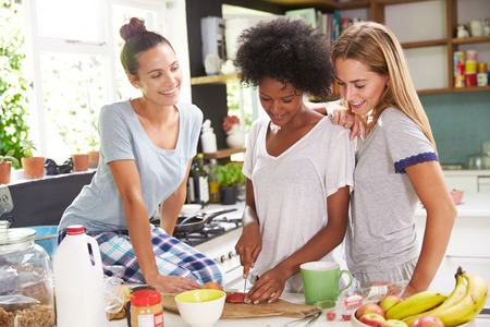 women friends: Three Female Friends Enjoying Breakfast At Home Together Stock Photo
