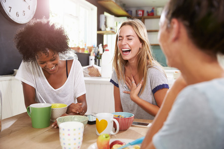 Three Female Friends Enjoying Breakfast At Home Together Stok Fotoğraf