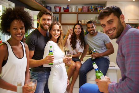 group of friends: Group Of Friends Enjoying Drinks Party At Home