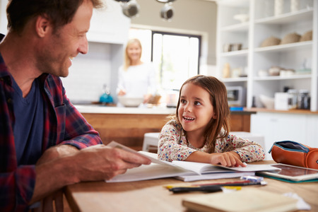 incidental people: Father home schooling his young daughter