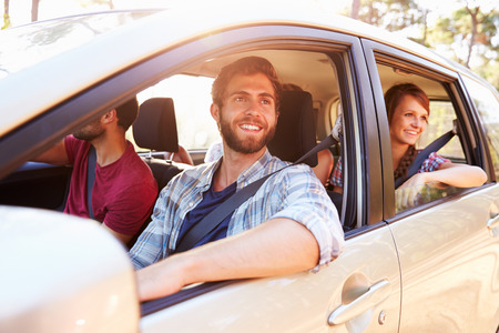 people happy: Group Of Friends In Car On Road Trip Together Stock Photo