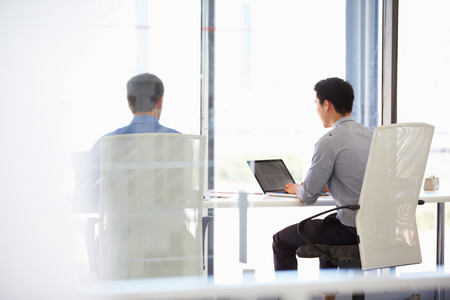 two people only: Two people working in a modern office Stock Photo